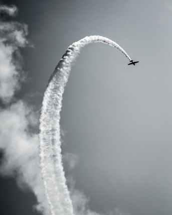 airplane contrail grayscale photo